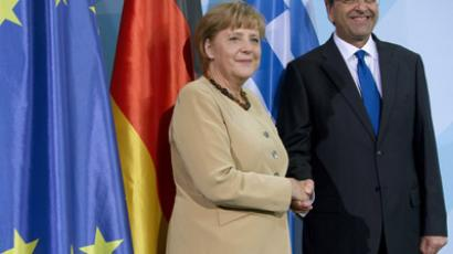 German Chancellor Angela Merkel and Greece's prime minister Antonis Samaras shake hands after a press conference on August 24, 2012 at the Chancellery in Berlin. (AFP Photo/David Gannon)