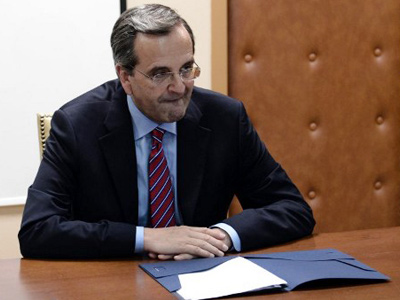 Greek Prime Minister Antonis Samaras meets with the finance minister at the Finance Ministry in Athens on August 8, 2012. (AFP Photo / Aris Messinis)