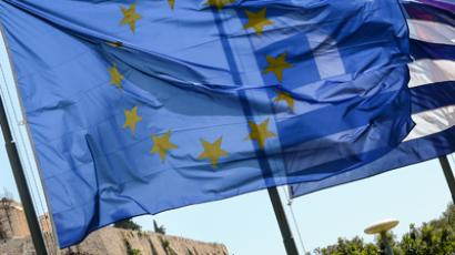 European Union flag and Greek flag wave in front of the Acropolis.(AFP Photo / Andreas Solaro)