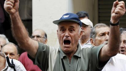 A pensioner shouts slogans during a protest against health cuts in front of the Ministry of Health in Athens on Sepember 4, 2012, where some 200 pensioners broke into the ministry demanding to meet with ministers. (AFP Photo/Kostas Tsironis)