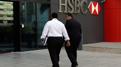 Men walk into of a branch of HSBC (Reuters/Nikhil Monteiro)