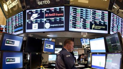 Traders work on the floor of the New York Stock Exchange.(AFP Photo / Allison Joyce)