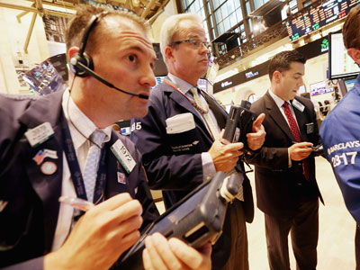 Traders work on the floor of the New York Stock Exchange during afternoon trading.(AFP Photo / Mario Tama)