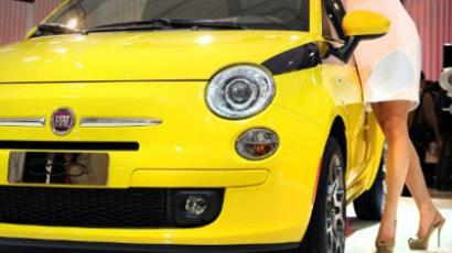 A model poses by a Fiat 500  (AFP Photo / Philippe Lopez)
