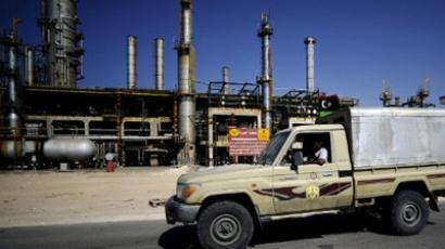 Some of the oil contarcts with Lybia could be disrupted (AFP Photo / Filippo Monteforte)