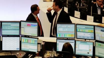 Traders are pictured at their desks at the Frankfurt stock exchange May 8, 2012 (Reuters/Remote/Fabrizio Bensch)