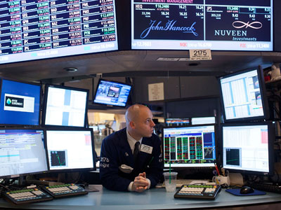A trader works on the floor of the New York Stock Exchange.(AFP Photo / Andrew Burton)