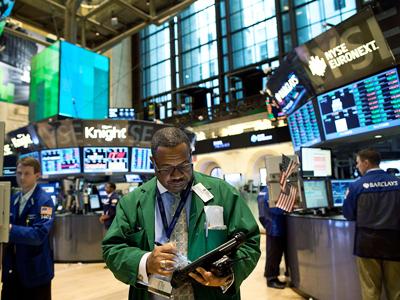 Traders work on the floor of the New York Stock Exchange.(AFP Photo / Andrew Burton)