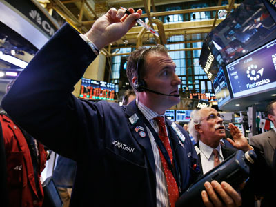 Traders work on the floor of the New York Stock Exchange at the opening of the trading session in New York.(Reuters / Mike Segar)