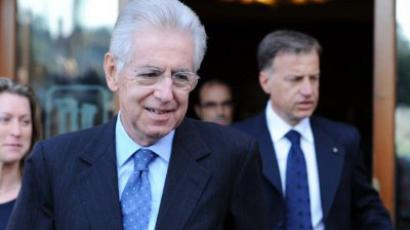 Former EU commissioner Mario Monti leaves his hotel on November 13, 2011 in Rome. (AFP Photo / Gabriel Bouy)