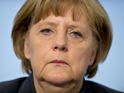 Merkel on defensive amid worries Germany too generous to Spain