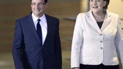 German Chancellor Angela Merkel (R) and the French president Francois Hollande (AFP Photo / Odd Andersen)