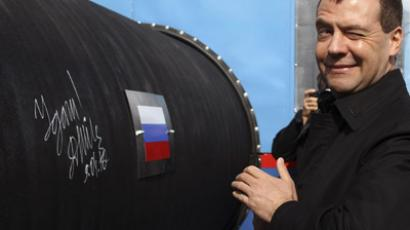 Russian President Dmitry Medvedev gestures after writing 'Good Luck!' on a pipe of the Nord Stream pipeline near Russian town of Vyborg (Reuters / Alexander Demianchuk)