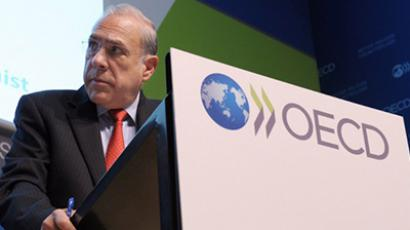 OECD Secretary General Angel Gurria looks on as he presents the OECD Economic Outlook at the OECD headquarters in Paris on November 27, 2012. (AFP Photo / Eric Piermont)