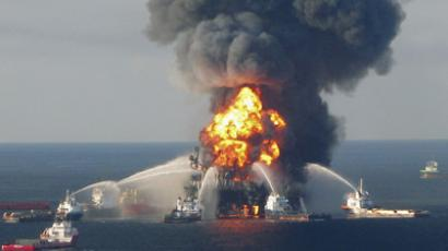 Fire boat response crews battle the blazing remnants of the offshore oil rig Deepwater Horizon, off Louisiana, in this April 21, 2010 file handout image.  (Reuters/U.S. Coast Guard/Files/Handout)