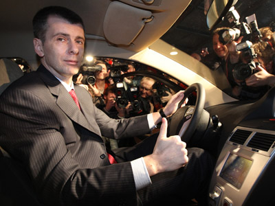 Mikhail Prokhorov, owner of Onexim Group, at the wheel, at the presentation of Onexim Group's hybrid cars held at a special pavilion on Tverskaya Street. Moscow. (RIA Novosti / Alexey Kudenko)