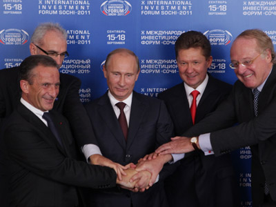 Russia's Prime Minister Vladimir Putin (C), Wintershall's member of board of executive directors Harald Schwager (L back), EDF's director general Henri Proglio (L front), Gazprom CEO Alexei Miller (2nd R) and ENI's director general Paolo Scaroni (R) shake hands at a ceremony of signing documents on South Stream gas pipeline project during the X International Investment Forum Sochi-2011 in Russian Black Sea resort of Sochi, September 16, 2011. (AFP Photo/Mikhail Mordasov)