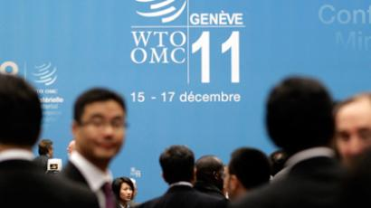 Delegates interact before the opening session of the 8th World Trade Organization Ministerial Conference in Geneva December 15, 2011 (Reuters / Denis Balibouse)