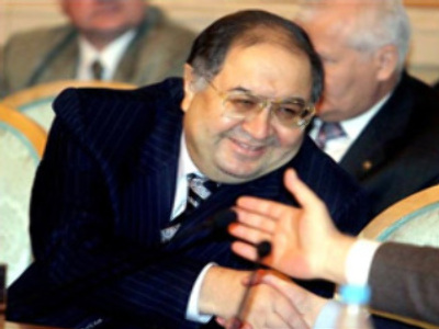Russian tycoon Usmanov bites bigger piece of Arsenal's cake
