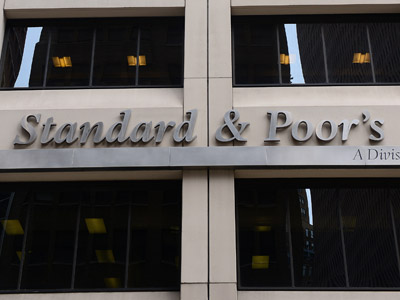 A sign for Standard & Poor's rating agency stands in front of the company headquarters in New York. (AFP Photo/Emmanuel Dunand)