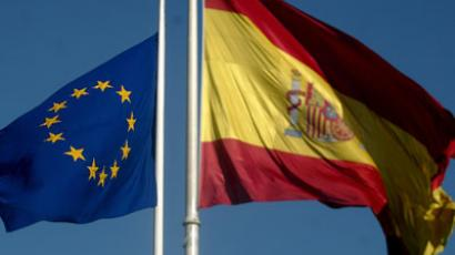 The Spanish flag and the European flag wave at the Colon square in Madrid, on the eve of the voting of the European Constitution in Spain. (AFP Photo / Pedro Armestre)