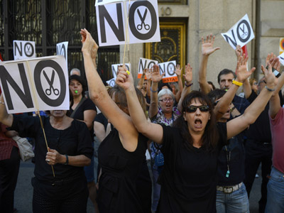 Government employees demonstrate against the Spanish government's austerity measures on August 3, 2012 in Madrid. (AFP Photo/Pierre Philippe Marcou)