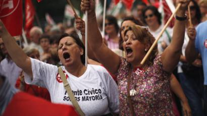 Demonstrators shout slogans as they hold flags of the General Workers Union (UGT) during a protest against further tax hikes and austerity cuts in Malaga, southern Spain October 7, 2012.  (Reuters/Jon Nazca)