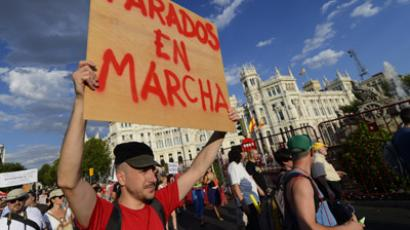 "A man holding a placard reading "" Unemployees are going"" takes part with hundreds of unemployed Spaniards in a demonstration against the Spanish government's latest austerity measures, in the center of Madrid on July 21, 2012. (AFP Photo/Pierre-Philippe Marcou)"