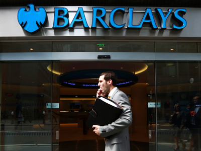 A man walks past a branch of Barclays Bank in the City of London, June 28, 2012 (Reuters/Olivia Harris)