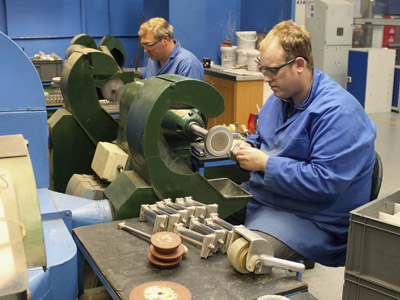 Employees of JJ Churchill precision engineering polish turbine blades in the company's factory in Market Bosworth, central England (Reuters/Tom Bergin)