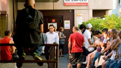 Unemployed workers wait outside a government job centre in Madrid (AFP Photo)