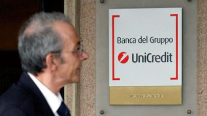 A man looks at a Unicredit logo as he arrives to attend the Unicredit shareholders' meeting in Rome.(REUTERS / Giampiero Sposito)