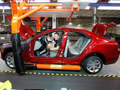 A General Motors' worker assembles a 2013 Cadillac ATS on the assembly line at the General Motors Lansing Grand River Assembly Plant.(AFP Photo / Bill Pugliano)