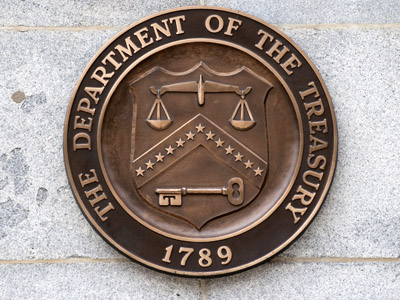 The logo of the US Treasury Department is seen on the outside of the Treasury building in Washington (AFP Photo/Saul Loeb)