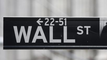 A Wall Street sign is seen in front of the exterior of the New York Stock Exchange  (Reuters/Chip East)