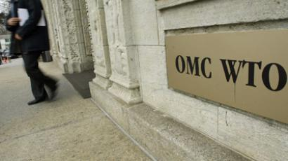 A person gets out of the World Trade Organization (WTO) headquarter in Geneva (AFP Photo/Fred Dufour)