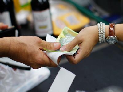 Venezuelan currency devalued by a third