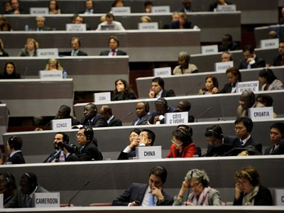 Delegates attend the opening of a World Trade Organization ministerial conference delayed due to technical problems, on December 15, 2011 in Geneva (AFP Photo / FABRICE COFFRINI)