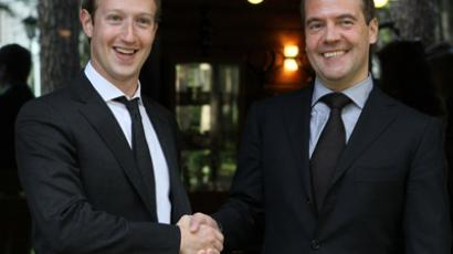 Russian Prime Minister Dmitry Medvedev (R) meets with Mark Zuckerberg, a co-founder and the chief executive of the social networking site Facebook, in the Gorki residence, Moscow Region, October 1, 2012. (RIA Novosti/Ekaterina Shtukina)