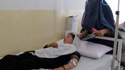 An Afghan schoolgirl receives treatment at a hospital after being poisoned in Takhar province May 23, 2012 (Reuters/Wahdat)
