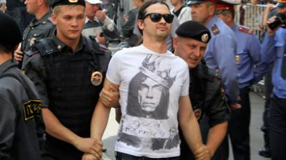 Police detain a Pussy Riot supporter outside the Khamovnichesky Court (Reuters/Sergei Karpukhin)