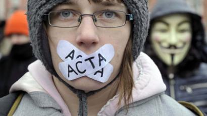 Demonstrators protest against signing of the international copyright agreement ACTA (Anti-Counterfeiting Trade Agreement). (Reuters / Srdjan Zivulovic)