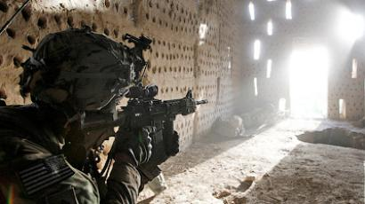 U.S. soldier Nicholas Dickhut from 5-20 infantry Regiment attached to 82nd Airborne points his rifle at a doorway after coming under fire by the Taliban while on patrol in Zharay district in Kandahar province, southern Afghanistan April 26, 2012 (Reuters/Baz Ratner)
