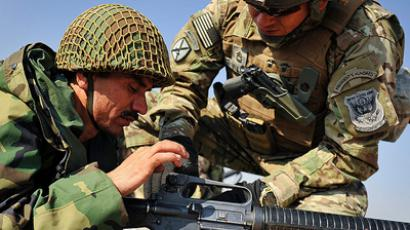 A US Army Marksmanship Unit member helps an Afghan National Army soldier make adjustments to his M-16 rifle during the Basic Rifle Marksmanship Instructor Course at Kabul Military Training Center, Afghanistan (ISAF photo by US Air Force Staff Sgt. Joseph Swafford)