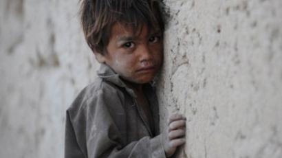 An Afghan boy leans against a wall as he cries on the outskirts of Kabul on October 4, 2011 (AFP Photo / ShahMarai)