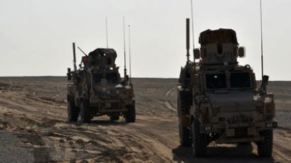 S Army's MRAP (Mine Resistant Ambush Protected) armored fighting vehicles from Route Clearance Platoon 3rd Light Armored Reconaissance Battalion, 2nd Marine Division (Forward) park in line in Banadar corridor, Garmsher district, Helmand province as they search for Improvised Explosive Devices (IEDs) set by insurgents (AFP Photo / Bay Ismoyo)