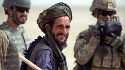 An Afghani man is processed for biodata by a US soldier from the 1st Platoon, 1-64 Armoured Batallion, US Army (AFP Photo)
