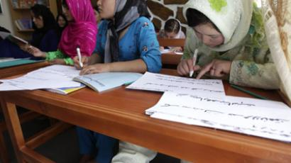 Sakina, 13, writes in a literacy class at the Family Guidance Center women's shelter in Kabul (Reuters / Lucy Nicholson)