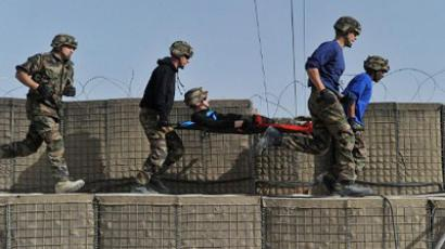 French soldiers with the NATO-led International Security Assistance Force (ISAF) carry another soldier during a mock medical drill at their base at the Surobi district in Kabul province on March 17, 2012 (AFP Photo / Shah Marai)
