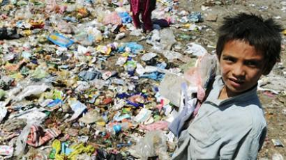 Afghan children scavenge for plastic and metal items at a rubbish dump in Kabul (AFP Photo / Shah Marai)